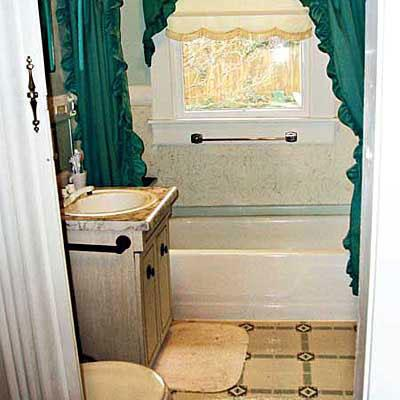 dépassé bathroom with a window in the shower stall, yellow tile on the floor and a green shower curtain