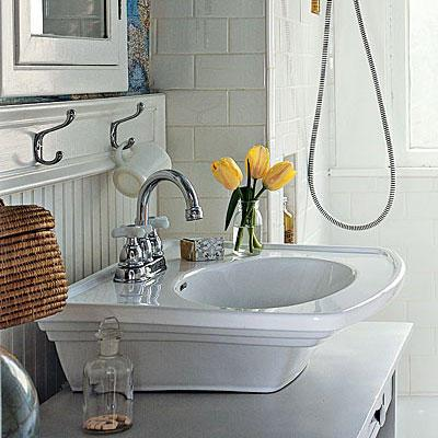 élevé white sink with a steel faucet and beaded board walls in a renovated bathroom project